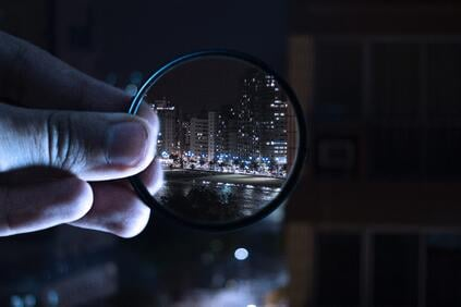 person-holding-magnifying-glass-712786